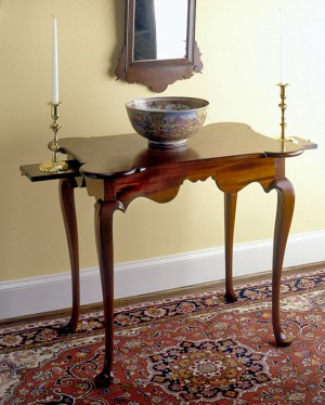 Queen Anne Mahogany Tea Table with Candleslides