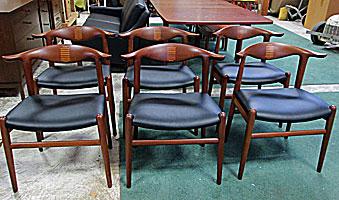 teak dining room chairs designed by Hans Wegner for Johannes Hansen